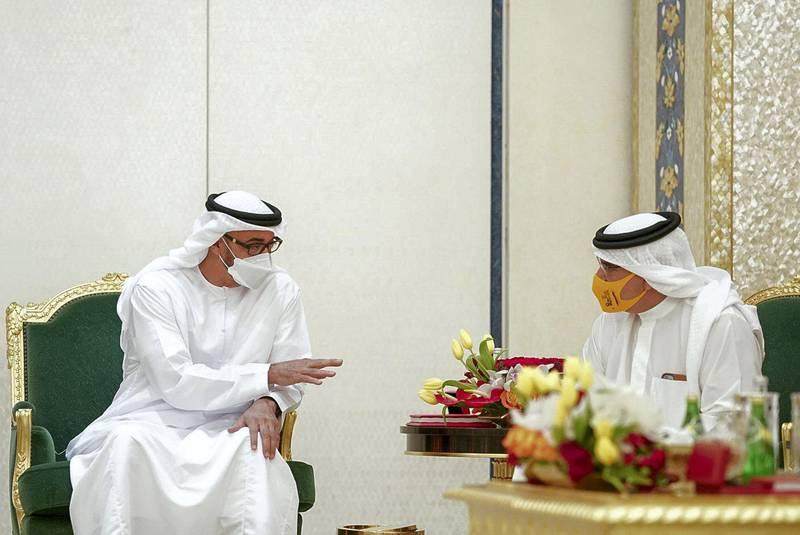 GHANTOOT, ABU DHABI, UNITED ARAB EMIRATES - November 18, 2020: HH Sheikh Mohamed bin Zayed Al Nahyan, Crown Prince of Abu Dhabi and Deputy Supreme Commander of the UAE Armed Forces (L), speaks with HRH Prince Salman Bin Hamad Bin Isa Al Khalifah Crown Prince and First Deputy Supreme Commander of Bahrain (R), during a tripartite summit between the UAE, Bahrain and Jordan.   ( Rashed Al Mansoori / Ministry of Presidential Affairs ) ---