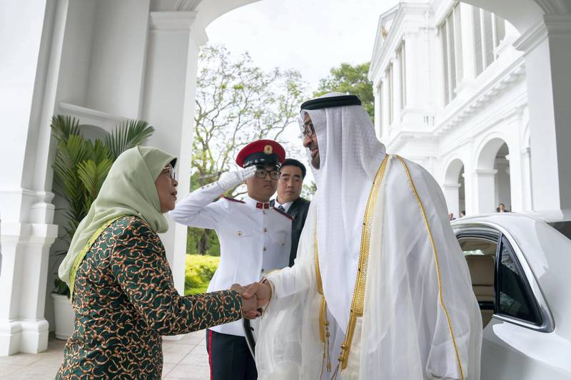SINGAPORE, SINGAPORE - February 28, 2019: HE Halimah Yacob, President of Singapore (L) receives HH Sheikh Mohamed bin Zayed Al Nahyan, Crown Prince of Abu Dhabi and Deputy Supreme Commander of the UAE Armed Forces (R), at the Istana presidential palace. ( Mohamed Al Hammadi / Ministry of Presidential Affairs ) —