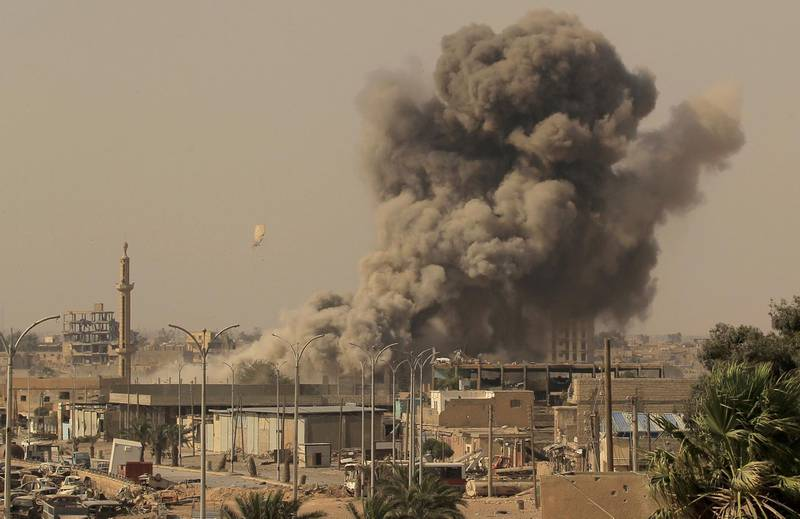 """Smoke rises after an air strike during fighting between members of the Syrian Democratic Forces and Islamic State militants in Raqqa, Syria, August 15, 2017. Zohra Bensemra: """"Access to the frontline of the battle for Raqqa in Syria was more limited than during the battle for Mosul in Iraq. RaqqaÕs battle was different also from MosulÕs because we saw very few civilians who managed to escape. We didnÕt have daily access. We were often posted in buildings used as a command base or observation point. From there we could photograph troop movements and smoke after air strikes. On this day, we were refused permission to go to the frontline. They said it was too dangerous and there was no armoured car. Even so, we decided to wait with the hope of advancing towards the combat zone. We were sitting with SDF members when we learned from one of the officers that there was going to be an air strike. To our surprise, the target building was close-by."""" REUTERS/Zohra Bensemra/File Photo  SEARCH """"POY IS"""" FOR THIS STORY. SEARCH """"REUTERS POY"""" FOR ALL BEST OF 2017 PACKAGES. TPX IMAGES OF THE DAY"""
