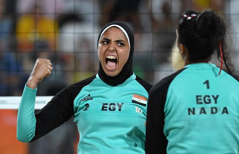 RIO DE JANEIRO, BRAZIL - AUGUST 07:  Doaa Elghobashy of Egypt reacts during the Women's Beach Volleyball preliminary round Pool D match against Laura Ludwig and Kira Walkenhorst of Germany on Day 2 of the Rio 2016 Olympic Games at the Beach Volleyball Arena on August 7, 2016 in Rio de Janeiro, Brazil.  (Photo by Shaun Botterill/Getty Images)