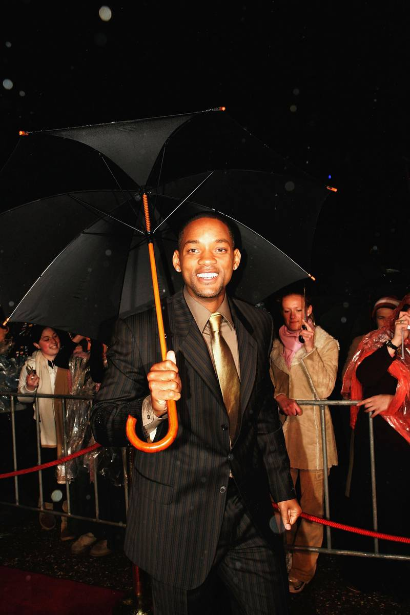 """SYDNEY, AUSTRALIA- JULY 19:  Actor Will Smith walks the red carpet under heavy rain at the premiere of """"I,Robot"""" at Fox Studios July 19, 2004 in Sydney, Australia. (Photo by Patrick Riviere/Getty Images)"""
