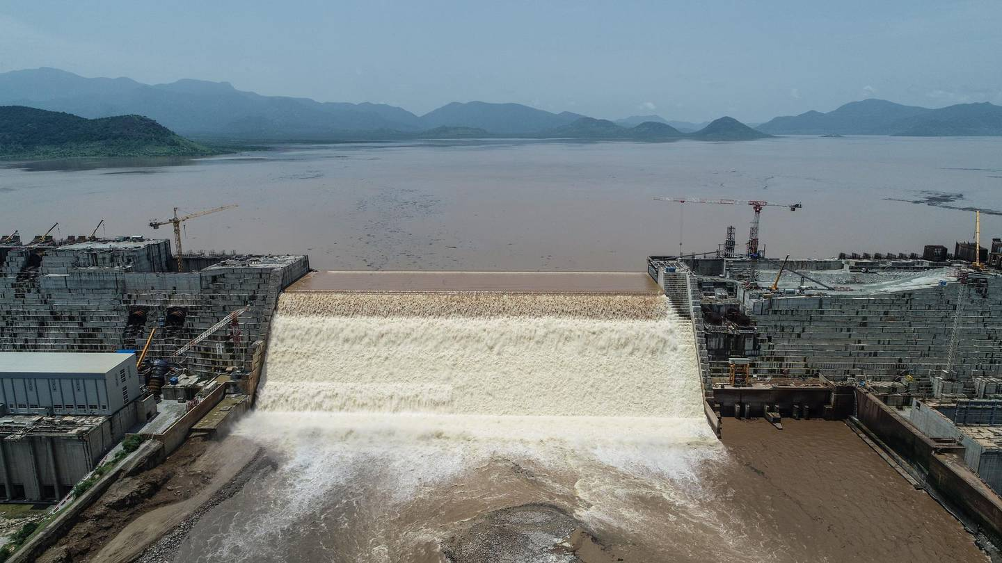 """This handout picture taken on July 20, 2020, and released by Adwa Pictures on July 27, 2020, shows an aerial view Grand Ethiopian Renaissance Dam on the Blue Nile River in Guba, northwest Ethiopia. - Ethiopia said on July 21 it had hit its first-year target for filling the Grand Ethiopian Renaissance Dam, a concrete colossus 145 metres (475 feet) high that has stoked tensions with downstream neighbours Egypt and Sudan. (Photo by - / Adwa Pictures / AFP) / RESTRICTED TO EDITORIAL USE - MANDATORY CREDIT """"AFP PHOTO / ADWA PICTURES """" - NO MARKETING NO ADVERTISING CAMPAIGNS - DISTRIBUTED AS A SERVICE TO CLIENTS / """"The erroneous mention[s] appearing in the metadata of this photo by Yirga MENGISTU has been modified in AFP systems in the following manner: [ - ] instead of [Yirga Mengitsu]. Please immediately remove the erroneous mention[s] from all your online services and delete it (them) from your servers. If you have been authorized by AFP to distribute it (them) to third parties, please ensure that the same actions are carried out by them. Failure to promptly comply with these instructions will entail liability on your part for any continued or post notification usage. Therefore we thank you very much for all your attention and prompt action. We are sorry for the inconvenience this notification may cause and remain at your disposal for any further information you may require."""""""