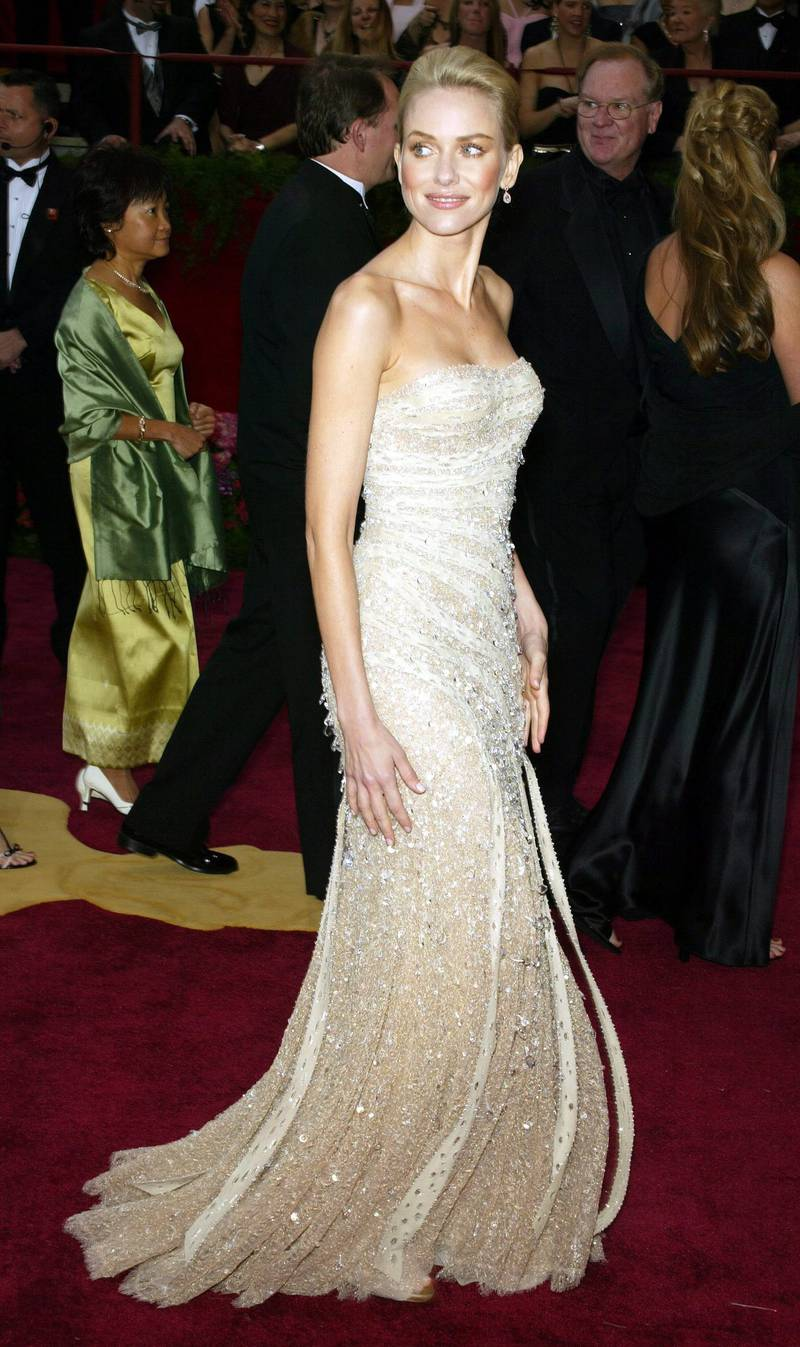 """epa00144733 Naomi Watts poses for the media on the arrival area for the 76th Annual Academy Awards in Hollywood California 29 February 2004.  Watts is nominated for best actress in her role in """"21 grams"""".  EPA/FRANCIS SPECKER"""