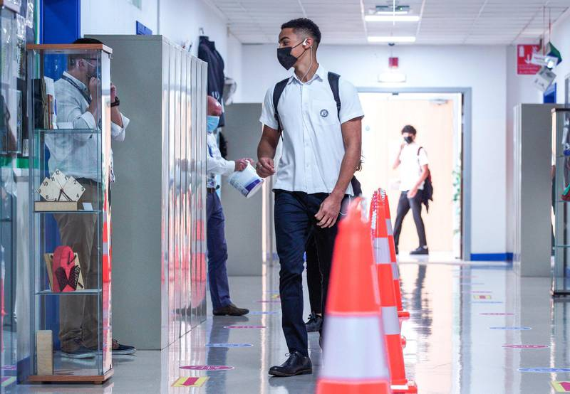 Abu Dhabi, United Arab Emirates, September 28, 2020.  First day back to classes on the reopening of British School Al Khubayrat, with Covid-19 protocols for the safety of  students, faculty and parents.  Victor Besa/The NationalSection:  NAReporter:  Haneen Dajani