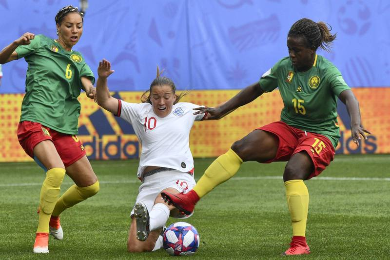 England's forward Francesca Kirby (C) vies with Cameroon's defender Estelle Johnson (L) and Cameroon's defender Ysis Sonkeng during the France 2019 Women's World Cup round of sixteen football match between England and Cameroon, on June 23, 2019, at the Hainaut stadium in Valenciennes, northern France. (Photo by Philippe HUGUEN / AFP)