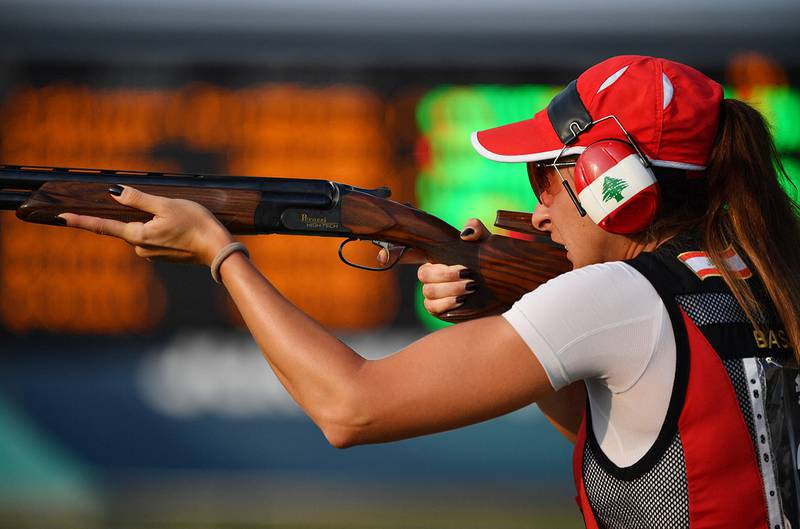 Lebanon's Ray Bassil competes in the trap mixed team shooting event at the 2018 Asian Games in Palembang on August 21, 2018. (Photo by ADEK BERRY / AFP)