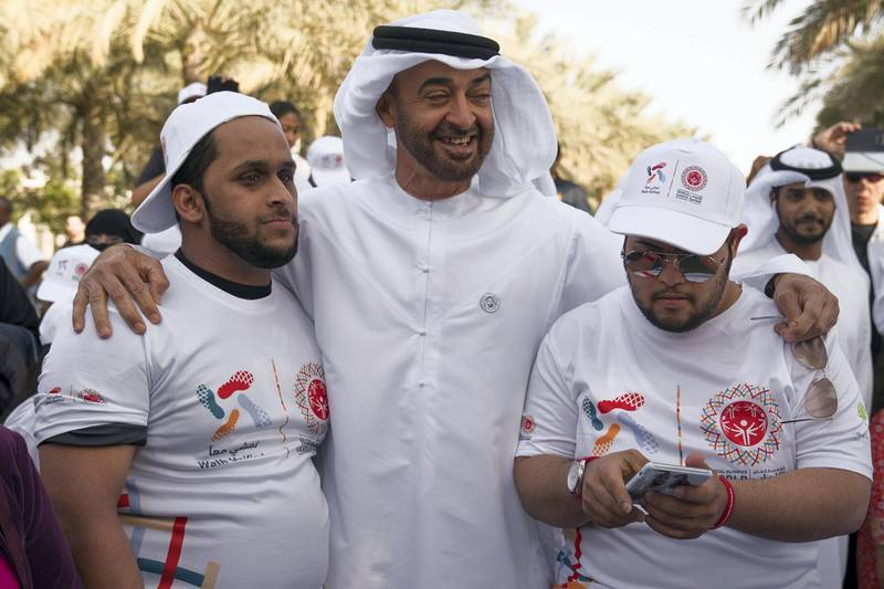 """ABU DHABI, UNITED ARAB EMIRATES - January 26, 2018: HH Sheikh Mohamed bin Zayed Al Nahyan, Crown Prince of Abu Dhabi and Deputy Supreme Commander of the UAE Armed Forces (C), stands for a photograph with participants during the Special Olympics Wold Games Abu Dhabi 2019 initiative """"Walk Unified"""", at Umm Al Emarat Park. ( Mohamed Al Hammadi / Crown Prince Court - Abu Dhabi ) ---"""