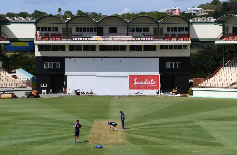 GROS ISLET, SAINT LUCIA - FEBRUARY 07:  England captain Joe Root and Head Coach Trevor Bayliss inspect the wicket during a Net Session at Darren Sammy National Cricket Stadium on February 07, 2019 in Gros Islet, Saint Lucia. (Photo by Shaun Botterill/Getty Images,)