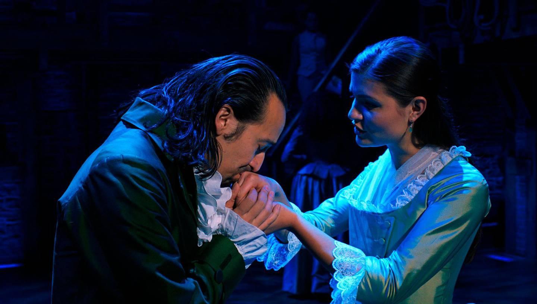 "In this image released by Disney Plus, Lin-Manuel Miranda portrays Alexander Hamilton, left, and Phillipa Soo portrays Eliza Hamilton in a filmed version of the original Broadway production of ""Hamilton."" (Disney Plus via AP)"