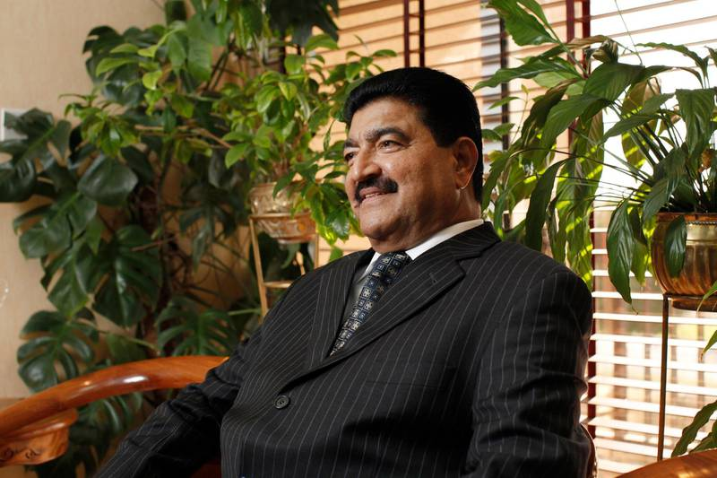 ABU DHABI, UNITED ARAB EMIRATES - December 31, 2009: Dr B. R. Shetty, Managing Director and CEO of NMC Group (NMC Specialty Hospital, UAE Exchange, Neopharma) sits for a portrait in his office.  ( Ryan Carter / The National ) *** Local Caption ***  RC005-DrShetty20091231.jpg