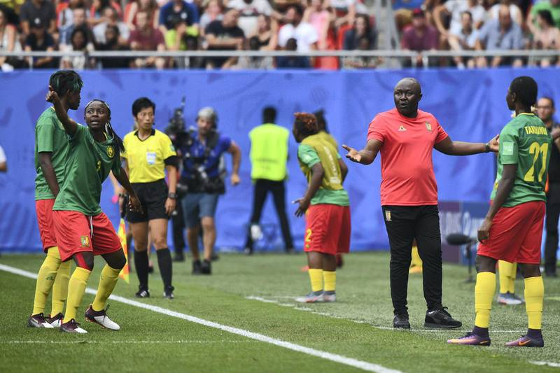 Cameroon's forward Ajara Nchout (2ndL) and Cameroon's coach Alain Djeumfa (2ndR) react after her goal was disallowed for offside during the France 2019 Women's World Cup round of sixteen football match between England and Cameroon, on June 23, 2019, at the Hainaut stadium in Valenciennes, northern France. (Photo by Philippe HUGUEN / AFP)