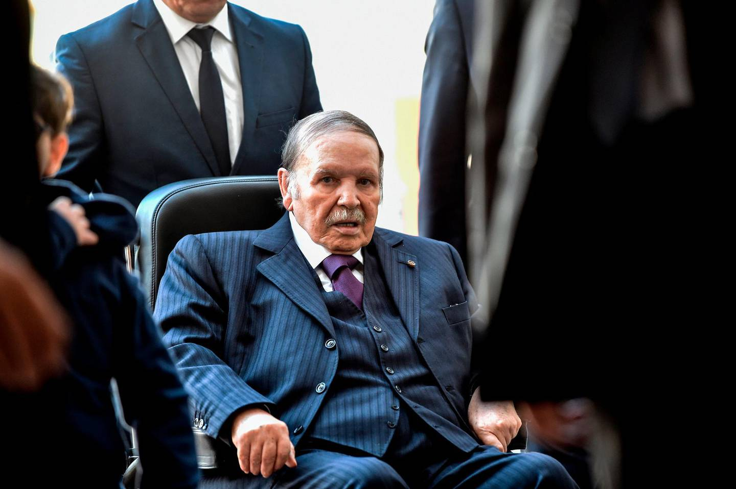 (FILES) In this file photo taken on November 23, 2017, Algerian President Abdelaziz Bouteflika is seen while voting at a polling station in the capital Algiers during polls for local elections.  Algeria's President Abdelaziz Bouteflika announced on March 11, 2019 his withdrawal from a bid to win another term in office and postponed an April 18 election, following weeks of protests against his candidacy. Bouteflika, in a message carried by national news agency APS, said the presidential poll would follow a national conference on political and constitutional reform to be drawn up by the end of 2019. / AFP / RYAD KRAMDI