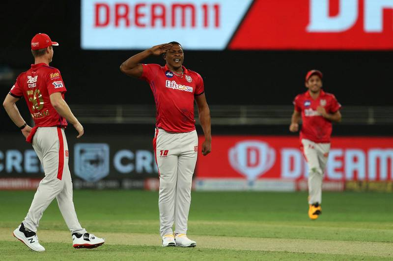 Sheldon Cottrell of Kings XI Punjab celebrates the wicket of Devdutt Padikkal of Royal Challengers Bangalore during match 6 of season 13 of the Dream 11 Indian Premier League (IPL) between Kings XI Punjab and Royal Challengers Bangalore held at the Dubai International Cricket Stadium, Dubai in the United Arab Emirates on the 24th September 2020.  Photo by: Ron Gaunt  / Sportzpics for BCCI
