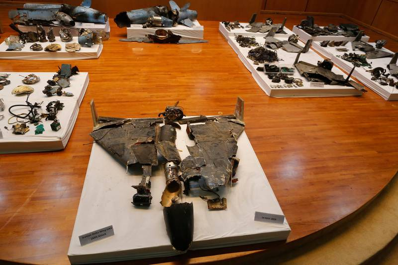 Remains of what was described as a misfired Iranian cruise missile used in an attack this weekend that targeted the heart of Saudi Arabia's oil industry, at background and a drone used on May 14, 2019 in an attack on Afif, in the Najd region, foreground, are displayed during a press conference by Saudi military spokesman Col. Turki al-Malki, in Riyadh, Saudi Arabia, Wednesday, Sept. 18, 2019. Though Yemen's Houthi rebels claimed the assault, the U.S. alleges Iran was behind it. (AP Photo/Amr Nabil)