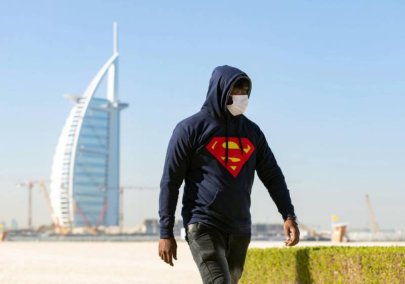 Dubai, United Arab Emirates - Reporter: N/A. News. Weather. A man walks along the beach with a hoodie on as the colder weather sets in. Dubai. Tuesday, January 5th, 2021. Chris Whiteoak / The National