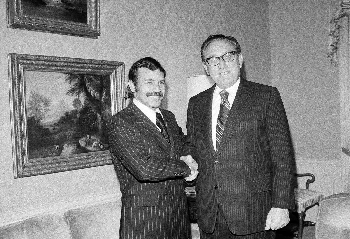 FILE - In this Oct. 1, 1975 file photo Abdelaziz Bouteflika, left, meets with U.S. Secretary of State Henry Kissinger at the U.S. State Department suite at the Waldorf Astoria Hotel Towers. Algerian President Abdelaziz Bouteflika stepped down on Tuesday April 2, 2019 after 20 years in office, and six weeks of massive nationwide protests aimed at pushing him and his much-criticized inner circle from power to create a real democracy in the gas-rich nation. (AP Photo/Dave Pickoff, File)