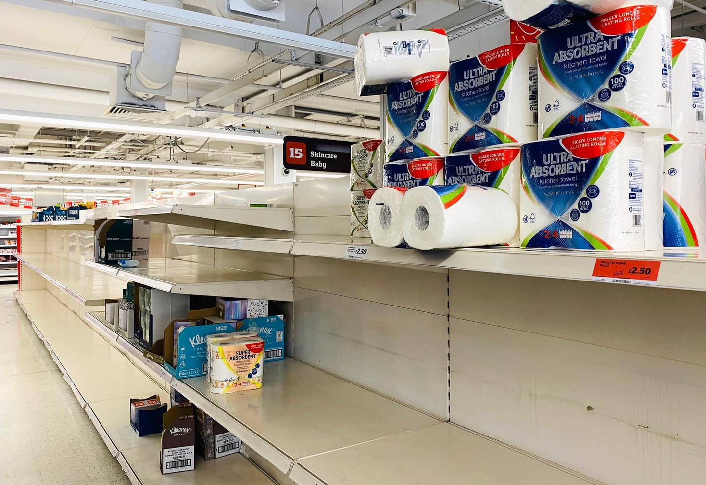 epa08274825 A general view of an almost empty aisle in a Sainsbury's supermarket in Central London, Britain, 06 March 2020. Reports suggest UK retailers are suffering supply disruptions because of the Covid-19 conoravirus.  EPA/WILL OLIVER