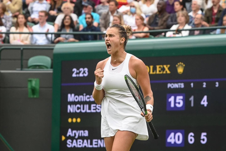 epa09307907 Aryna Sabalenka of Belarus celebrates winning against Monica Niculescu of Romania during their first round match at the Wimbledon Championships tennis tournament in Wimbledon, Britain, 28 June 2021.  EPA/FACUNDO ARRIZABALAGA