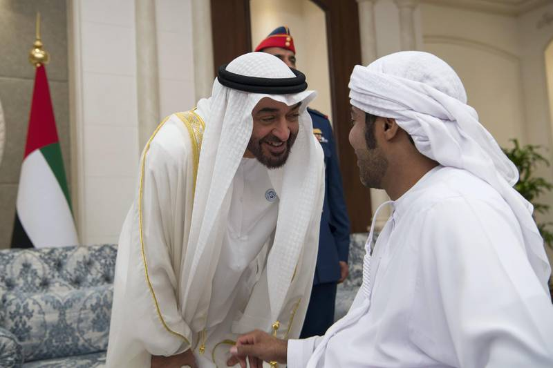 ABU DHABI, UNITED ARAB EMIRATES - June 15, 2018: HH Sheikh Mohamed bin Zayed Al Nahyan Crown Prince of Abu Dhabi Deputy Supreme Commander of the UAE Armed Forces (L), speaks with a guest during an Eid Al Fitr reception at Mushrif Palace.   ( Saeed Al Neyadi / Crown Prince Court - Abu Dhabi ) ---