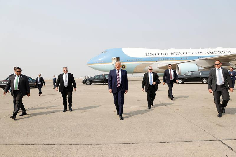 epa08939649 (FILE) US President Donald J. Trump (C) walks towards the media platform surrounded by his secret service detail after arriving on Air Force One at Sacramento McClellan Airport in McClelland Park, California, USA, 14 September 2020. The President visited Sacramento County to be briefed on the deadly wildfires that have burned more than three million acres across California. The presidency of Donald Trump, which records two presidential impeachments, will end at noon on 20 January 2021.  EPA-EFE/JOHN G. MABANGLO *** Local Caption *** 56621663