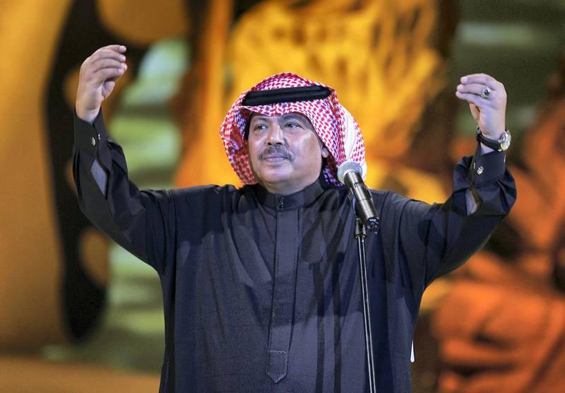 Saudi singer star Abu Baker Salem performs late 12 January 2006 in Doha on the second night of Qatar's seventh Song Festival. The six-day annual festival is hosting several Arab pop stars and classical singers, including Iraq's top singer Kazem al-Saher, Egypt's Shirin and Saudi Arabia's Mohammed Abdo. AFP PHOTO/KARIM JAAFAR / AFP PHOTO / KARIM JAAFAR