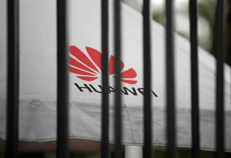 FILE PHOTO: A Huawei logo is seen outside the fence at its headquarters in Shenzhen, Guangdong province, China May 29, 2019. REUTERS/Jason Lee/File Photo