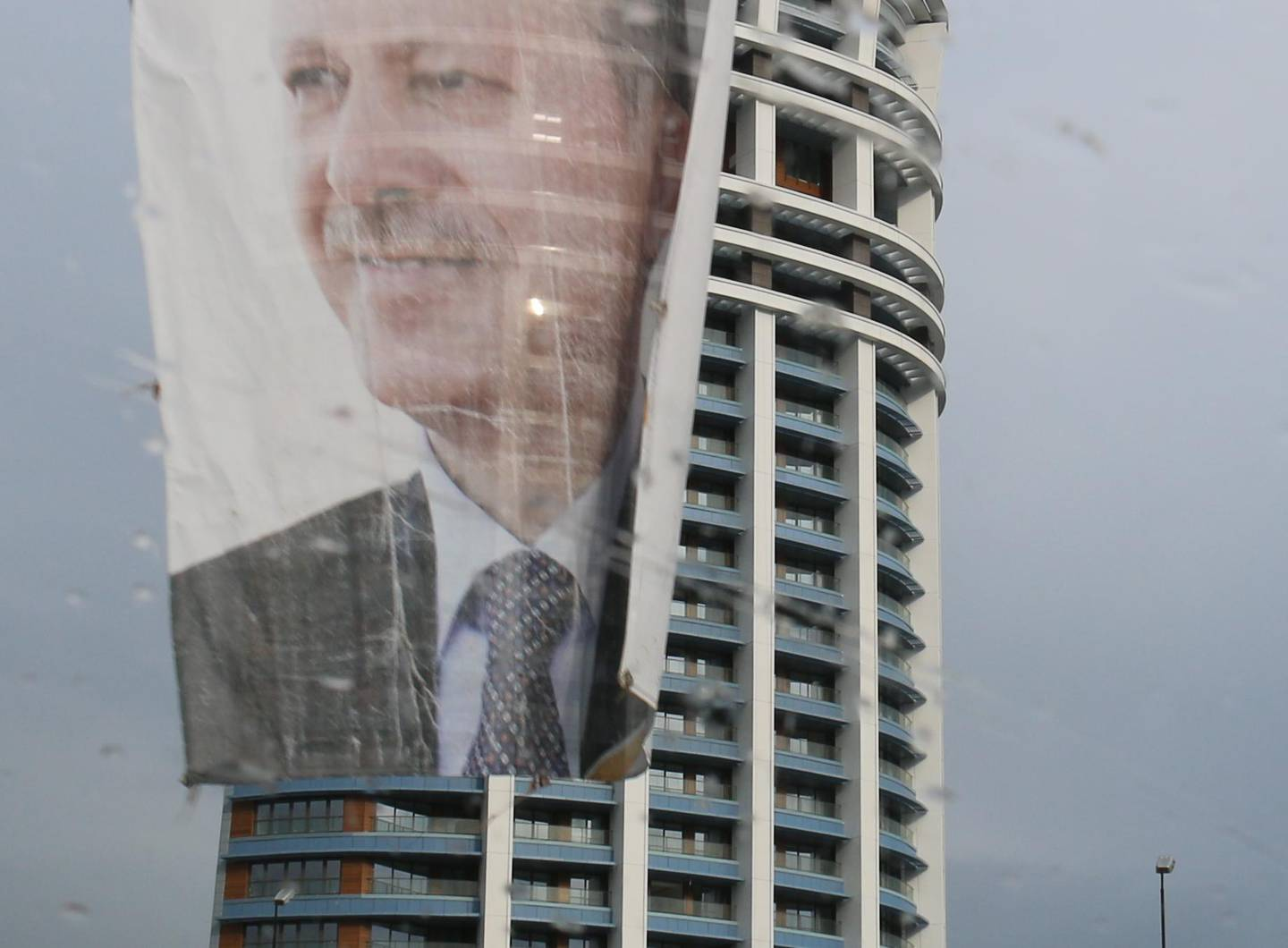 ISTANBUL - MARCH 30: Turkish Prime Minister Recep Tayyip Erdogan's face adorns posters throughout Istanbul, even though the election is regional. This poster, seen through a car windshield on a rainy day, hangs above a highway. March 30, 2014.        (Tanya Talaga/Toronto Star via Getty Images)