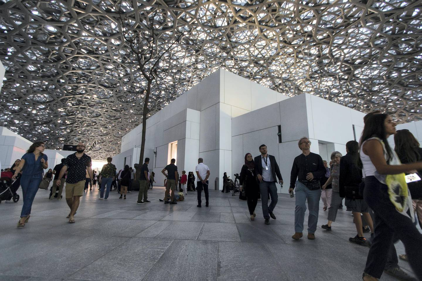 Abu Dhabi, United Arab Emirates, November 11, 2017:    Visitors attend the opening day at the Louvre Abu Dhabi on Saadiyat Island in Abu Dhabi on November 11, 2017. Christopher Pike / The National  Reporter: James Langton, John Dennehy Section: News