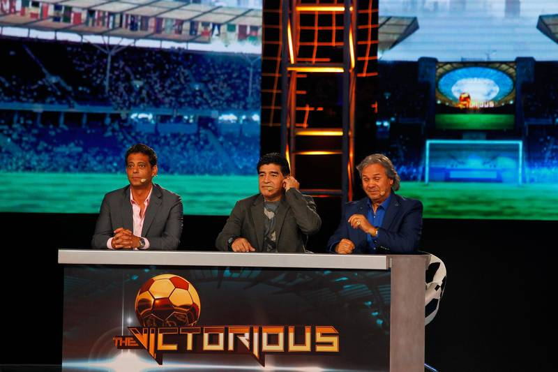 Dubai, United Arab Emirates - April 5, 2014.  ( Left to Right ) Hany Ramzy ( famous Egyptian ex footballer ), Diego Maradona ( world's famous footballer from Argentina ) and Rabah Madjer ( famous Algerian ex footballer ) at the gameshow Victorious.  ( Jeffrey E Biteng / The National )  Editor's Note;  John M reports.