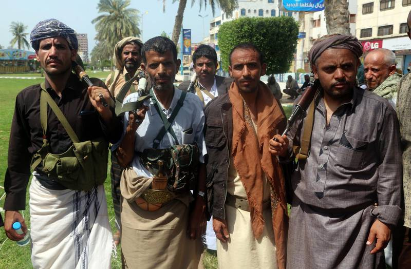 Shiite Huthi rebels are seen during a gathering to mobilise more fighters to the battlefront to fight pro-government forces, in the Red Sea port city of Hodeidah on June 18, 2018. The UAE, a key player in the coalition battling Huthi rebels in Yemen, warned the insurgents to withdraw unconditionally from the flashpoint port city of Hodeida, after UN peace efforts fizzled. / AFP / ABDO HYDER