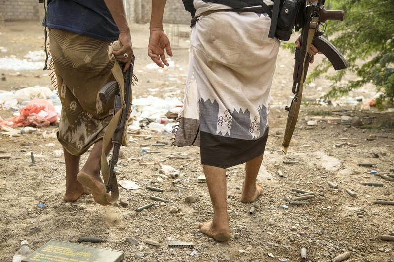 Members of the coalition-backed Tehama forces walk near bullets in  Hais district, Hudayda, June 2, 2018.  Photo/ Asmaa Waguih