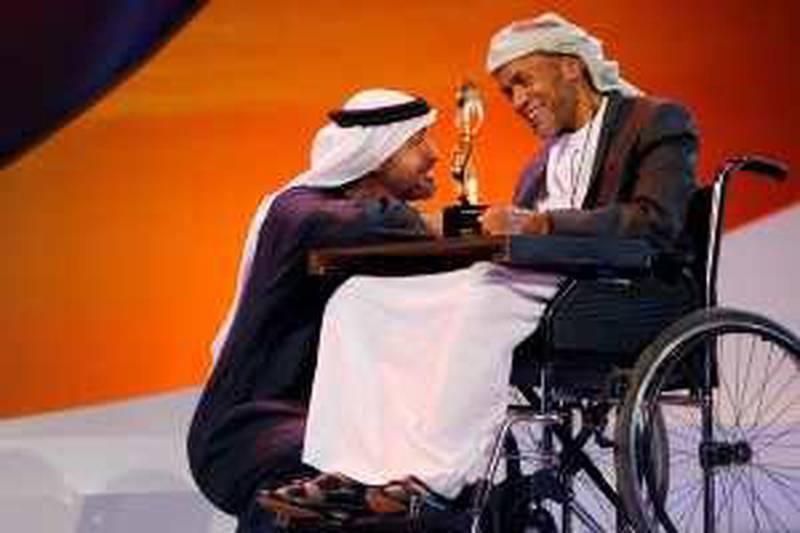 ABU DHABI, UNITED ARAB EMIRATES - February 14, 2010: The 2010 Abu Dhabi Awards at Emirates Palace.His Highness Sheikh Mohamed bin Zayed Al Nahyan awarding Saleh Salem Al YaÕrabi( Ryan Carter / EAA )