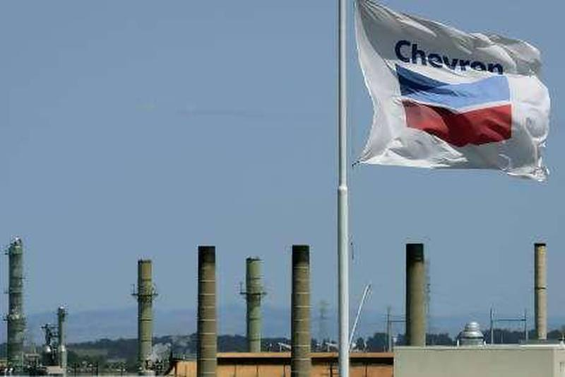A Chevron flag flies over the Chevron refinery Monday, April 21, 2008, in Richmond, Calif. Rising gasoline prices tightened the squeeze on drivers Monday, jumping to an average $3.50 a gallon at filling stations across the country. (AP Photo/Ben Margot)