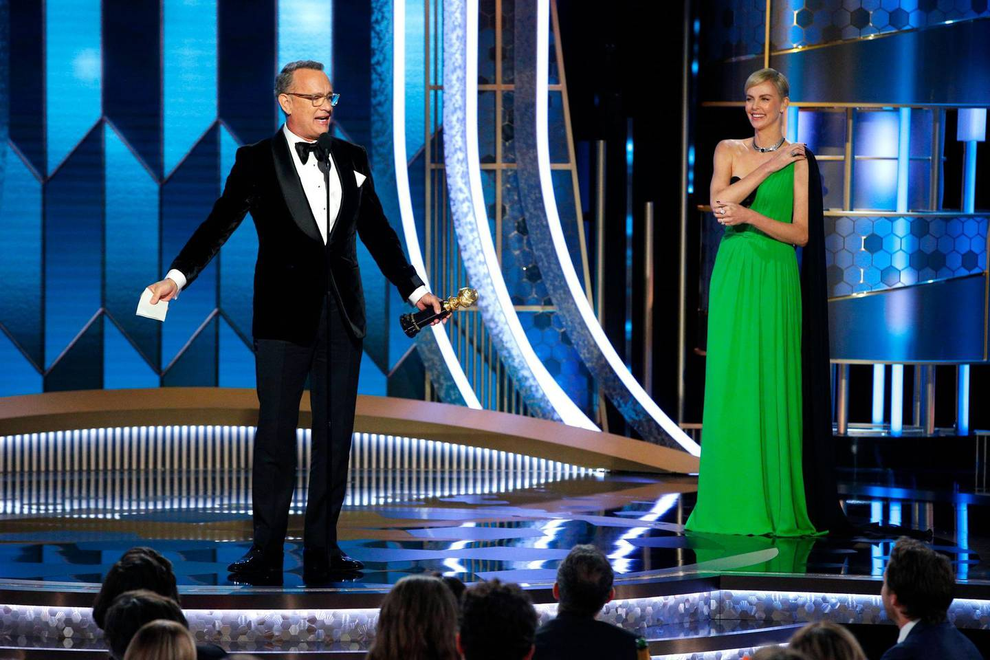 77th Golden Globe Awards - Show - Beverly Hills, California, U.S., January 5, 2020 - Tom Hanks accepts the Cecil B. DeMille Award as Charlize Theron looks on.   Paul Drinkwater/NBC Universal/Handout via REUTERS For editorial use only. Additional clearance required for commercial or promotional use, contact your local office for assistance. Any commercial or promotional use of NBCUniversal content requires NBCUniversal's prior written consent. No book publishing without prior approval. NO SALES. NO ARCHIVES.