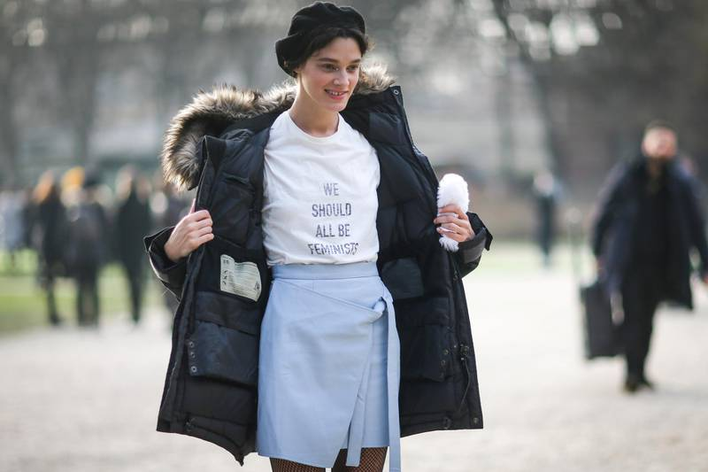 """PARIS, FRANCE - JANUARY 23:  A guest wears a white t-shirt with the inscriptions """" We should all be Feminists"""", and attends the Christian Dior Haute Couture Spring Summer 2017 show as part of Paris Fashion Week, at the Rodin museum, on January 23, 2017 in Paris, France.  (Photo by Edward Berthelot/Getty Images)"""