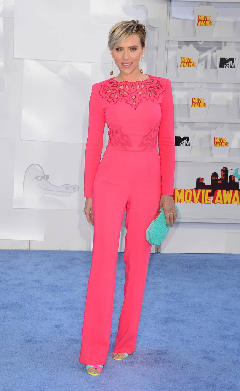 epa04702486 Actress Scarlett Johansson arrives for the 2015 MTV Movie Awards at the Nokia Theatre in Los Angeles, California, USA, 12 April 2015. The movies are nominated by producers and executives from MTV and the winners are chosen on-line by the general public.  EPA/MIKE NELSON