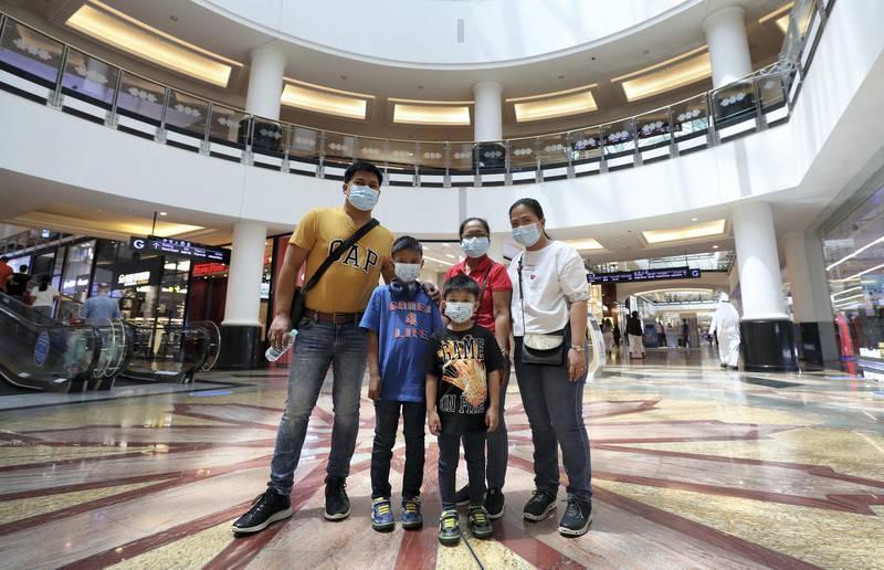 Dubai, United Arab Emirates - Reporter: Kelly Clarke. Coronavirus/Covid-19. Hilario Ubaldo (dad), Karen Mae (mum), Mercy Bueno (grandparent, M), Jettliam Ubaldo (R) and Geoff Ivan. Parents rush to buy PPE for children in time for back-to-school. Sunday, August 23rd, 2020. Dubai. Chris Whiteoak / The National