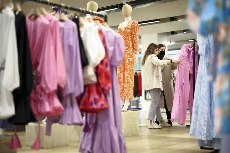 FILE PHOTO: People shop in the Selfridges department store on Oxford street, as the coronavirus disease (COVID-19) restrictions ease, in London, Britain April 12, 2021. REUTERS/Henry Nicholls/File Photo  GLOBAL BUSINESS WEEK AHEAD
