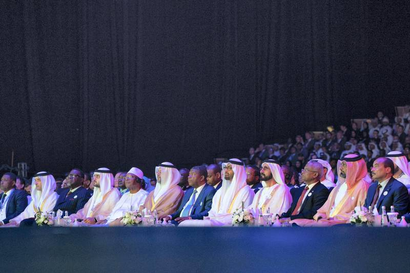 ABU DHABI, UNITED ARAB EMIRATES - January 14, 2019: HH Sheikh Mohamed bin Zayed Al Nahyan, Crown Prince of Abu Dhabi and Deputy Supreme Commander of the UAE Armed Forces (front row 5th R) and HH Sheikh Mohamed bin Rashid Al Maktoum, Vice-President, Prime Minister of the UAE, Ruler of Dubai and Minister of Defence (front row 4th R), attend the opening ceremony of the World Future Energy Summit 2019, part of Abu Dhabi Sustainability Week, at Abu Dhabi National Exhibition Centre (ADNEC). Seen with (front row) HE Mohamed Ould Abdel Aziz, President of Mauritania (R), HH Sheikh Ammar bin Humaid Al Nuaimi, Crown Prince of Ajman (2nd R), HE Ibrahim Mohamed Solih, President of the Maldives (3rd R), HE Joao Manuel Lourenco, President of Angola (6th R), HH Sheikh Sultan bin Mohamed Al Qasimi, Crown Prince of Sharjah (7th R), HE Ibrahim Boubacar Keita, President of Mali (8th R), HH Sheikh Maktoum bin Mohamed bin Rashid Al Maktoum, Deputy Ruler of Dubai (9th R), HE Hage Geingob, President of Namibia (10th R) and HH Sheikh Hazza bin Zayed Al Nahyan, Vice Chairman of the Abu Dhabi Executive Council (11th R).   ( Mohamed Al Hammadi / Ministry of Presidential Affairs ) ---
