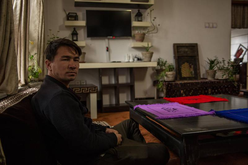 Abdullah Mahmoodi, owner of the highland hotel sits in the guesthouse's living room. All international tours have been cancelled.