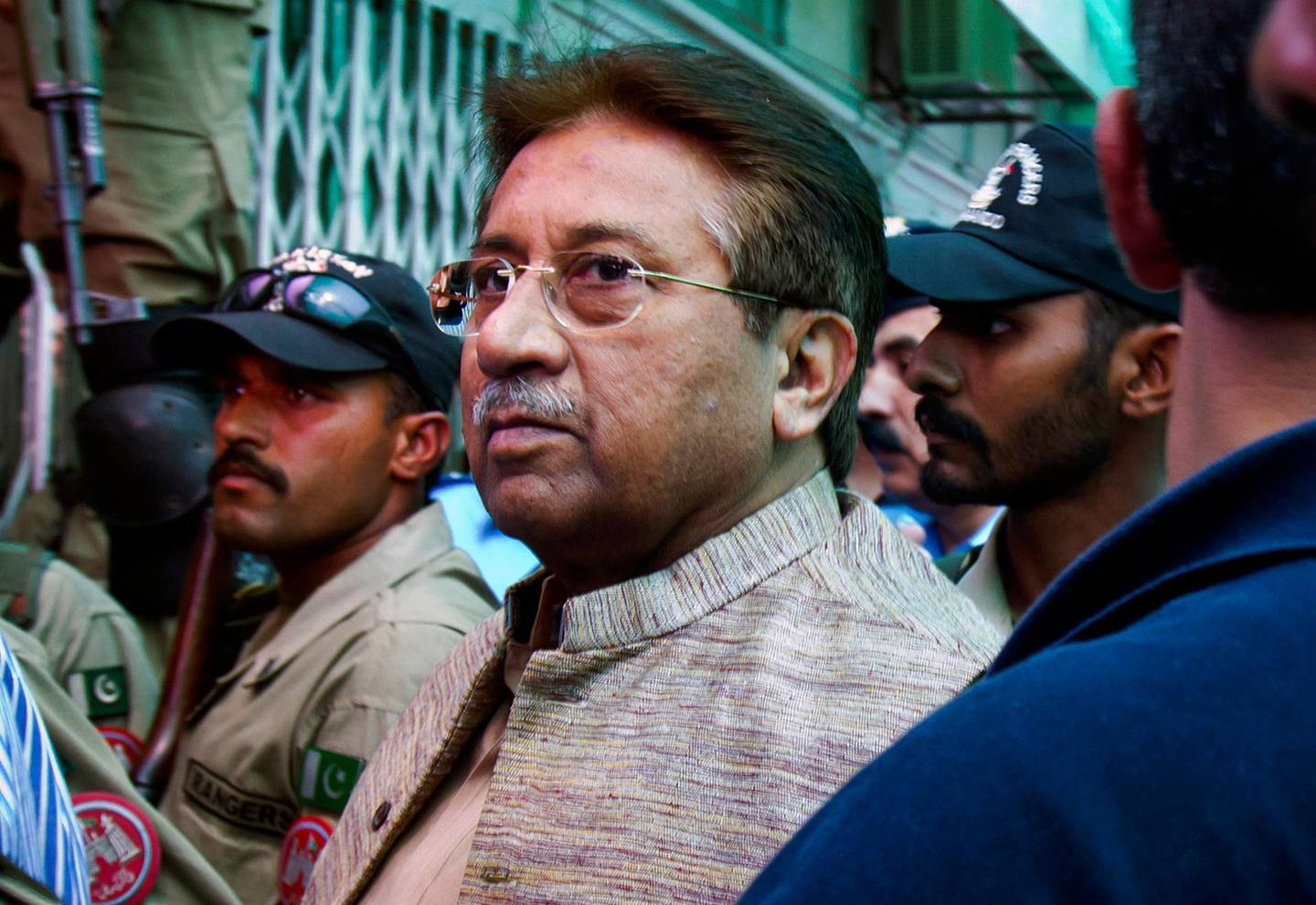 FILE - In this Saturday, April 20, 2013 file photo, Pakistan's former President and military ruler Pervez Musharraf arrives at an anti-terrorism court in Islamabad, Pakistan A lawyer said Tuesday, March 10, 2015 that a Pakistani court has issued arrest warrants for Musharraf in a case related to the death of a radical cleric. (AP Photo/Anjum Naveed, File)