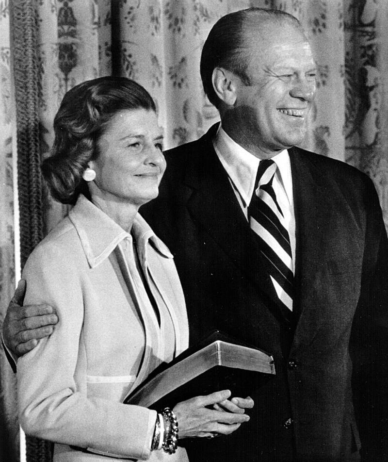 37888 07: First Lady Betty Ford holds onto the bible that her husband Gerald Ford used to take the oath for the President of the United States August 9, 1974 in Washington. (Photo by Newsmakers/National Archives)
