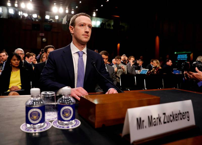 FILE PHOTO: Facebook CEO Mark Zuckerberg arrives to testify before a Senate Judiciary and Commerce Committees joint hearing regarding the company's use and protection of user data, on Capitol Hill in Washington, U.S., April 10, 2018. Picture taken April 10, 2018.  REUTERS/Aaron P. Bernstein/File Photo
