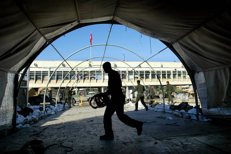 KABUL, AFGHANISTAN - FEBRUARY 7:  Turkish International Security Assistance Force (ISAF) soldiers take down their mess hall tent at the APOD military base located at the Kabul International Airport February 7, 2003 in Kabul, Afghanistan. After seven and a half months the Turkish forces are pulling out of Afghanistan and will hand over the mission to the German-Netherlands Corps on the 10th of February.  (Photo by Paula Bronstein/Getty Images)