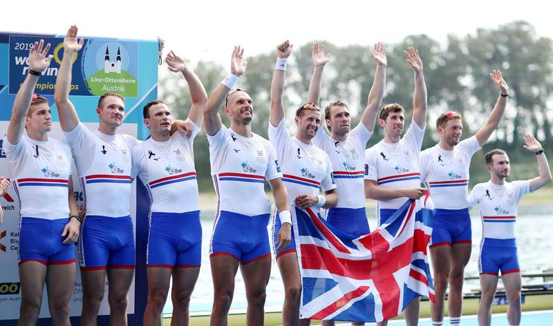 LINZ, AUSTRIA - SEPTEMBER 01: Tom George, James Rudkin, Josh Bugajski, Mohamed Sbihi, Jacob Dawson, Ollie Wynne-Griffith, Matthew Tarrant, Tom Ford and coxswain Henry Fieldman of Great Britain celebrate at the victory ceremony after winning the Bronze medal in the Men's 8 final during Day Eight of the 2019 World Rowing Championships on September 01, 2019 in Linz-Ottensheim, Austria. (Photo by Naomi Baker/Getty Images)