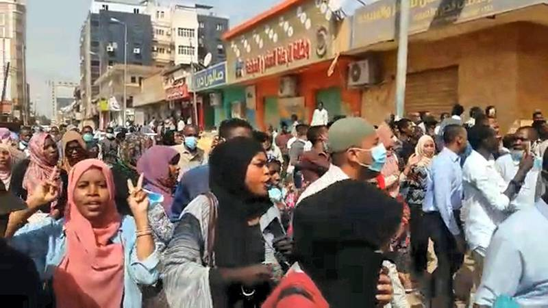 """An image grab taken from AFP TV on January 17, 2019, shows people chanting and shouting during a protest calling for the resignation of the Sudanese President in the capital Khartoum. - Sudanese police fired tear gas at hundreds of protesters marching towards the presidential palace demanding President Omar al-Bashir's resignation. Protesters chanting """"Freedom, peace, justice"""" gathered in central Khartoum and began their march but riot police quickly confronted them with tear gas, witnesses told AFP. (Photo by - / various sources / AFP)"""