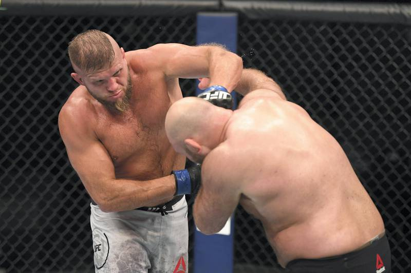 ABU DHABI, UNITED ARAB EMIRATES - OCTOBER 11: In this handout image provided by UFC,  (L-R) Marcin Tybura of Poland punches Ben Rothwell in their heavyweight bout during the UFC Fight Night event inside Flash Forum on UFC Fight Island on October 11, 2020 in Abu Dhabi, United Arab Emirates. (Photo by Josh Hedges/Zuffa LLC via Getty Images)