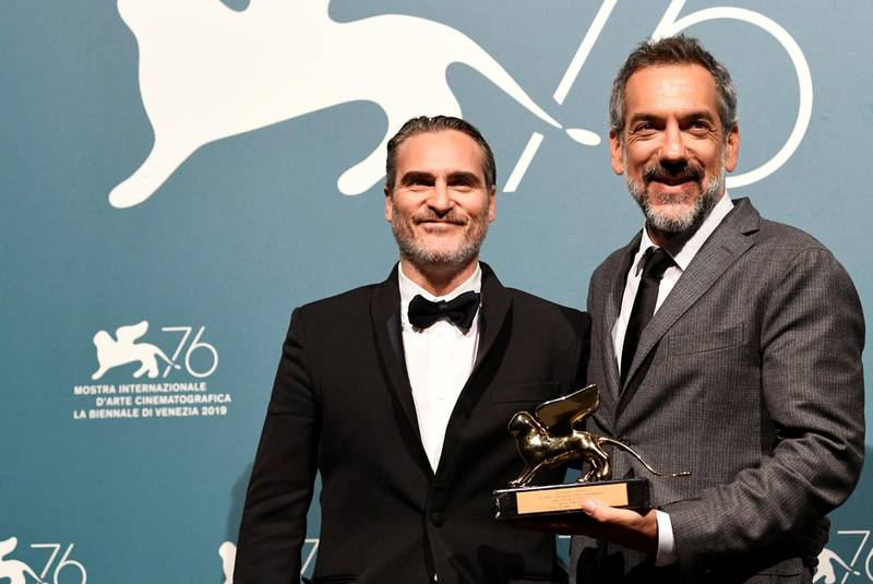 The 76th Venice Film Festival - Awards Ceremony - Venice, Italy, September 7, 2019 - Director Todd Phillips poses next to Joaquin Phoenix with the Golden Lion for Best Film. REUTERS/Piroschka van de Wouw