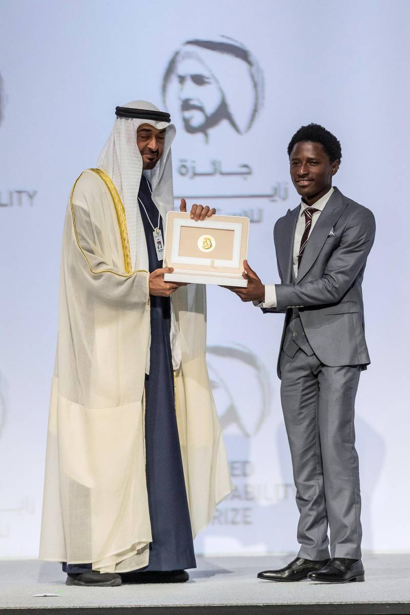 ABU DHABI, UNITED ARAB EMIRATES. 13 JANUARY 2020. The Zayed Sustainability Awards held at ADNEC as part of Abu Dhabi Sustainability Week. H.E. Sheikh Mohammed bin Zayed Al Nahyan, Crown Prince of Abu Dhabi and Deputy Supreme Commander of the United Arab Emirates Armed Forces awards Energy Winner: Food Winner: Okuafu Foundation, Ghana.  (Photo: Antonie Robertson/The National) Journalist: Kelly Clarker. Section: National.