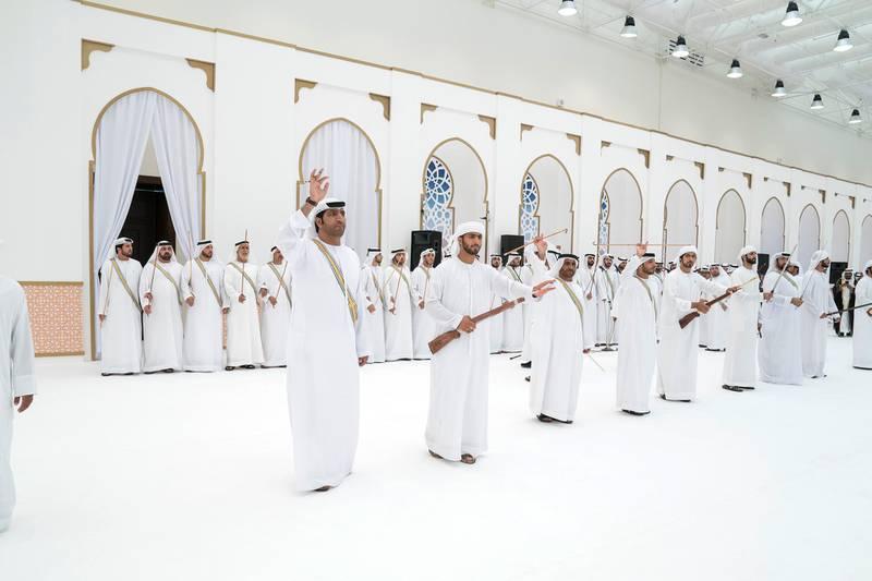 ADHAN, RAS AL KHAIMAH, UNITED ARAB EMIRATES - March 13, 2018: A traditional dance is performed during a mass wedding reception for HH Sheikh Mohamed bin Saud bin Saqr Al Qasimi, Crown Prince and Deputy Ruler of Ras Al Khaimah (not shown), at Mohamed bin Zayed, Al Bayt Mitwahid wedding hall.   ( Mohamed Al Hammadi / Crown Prince Court - Abu Dhabi ) ---